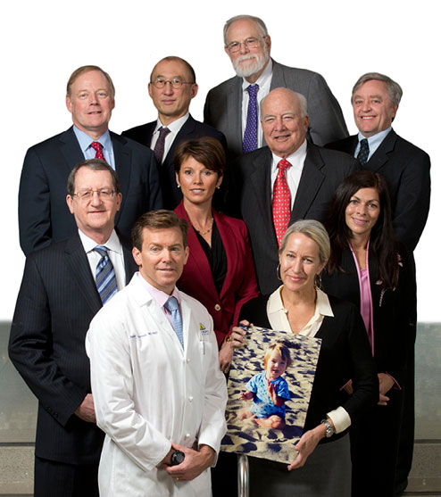 "Johns Hopkins Medicine's first patient safety workforce. Leading patient safety interventions for 15 years. Back row, from left: Richard ""Chip"" Davis, Albert Wu, George Dover and Dan Ford. Middle row, from left: Ronald R. Peterson, Rhonda Wyskiel, C. Michael Armstrong and Cheryl Conners. Front row, from left: Peter Pronovost and Sorrel King, holding a picture of Josie King."